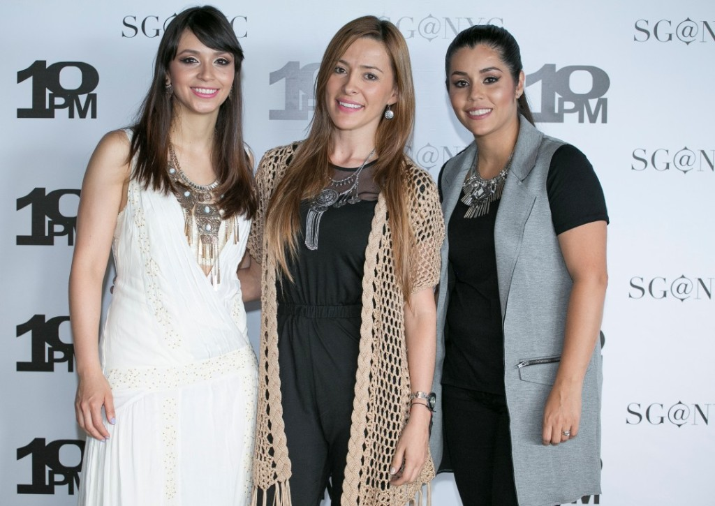 Stephanie, Sandra, and Claudia rocking the statement necklaces on the red carpet.