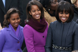 WASHINGTON, DC - JANUARY 21: First lady Michelle Obama and daughters, Sasha Obama and Malia Obama arrive during the presidential inauguration wearing J. Crew (Photo by Mark Wilson/Getty Images)